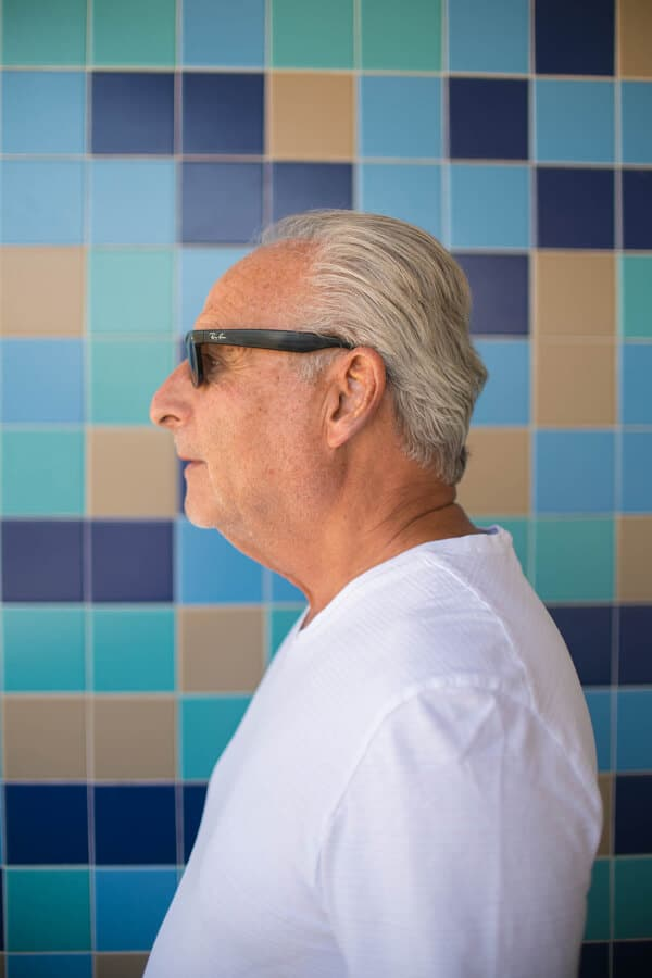older men medium length hairstyle posing at the hair salon