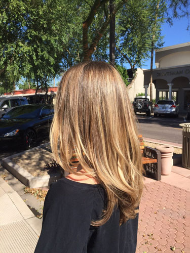 women's hair after balayage shadow